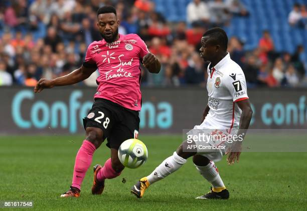 Montpellier's French midfielder Stephane Sessegnon vies with Nice's Ivorian midfielder Jean Michael Seri during the French L1 football match between...