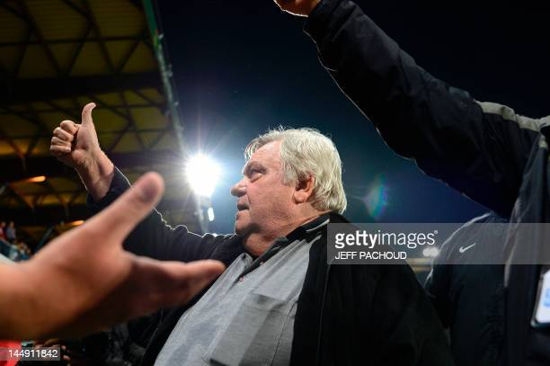 Montpellier's French president Louis Nicollin celebrates after his team won the French L1 football match against Auxerre and the French L1 football...