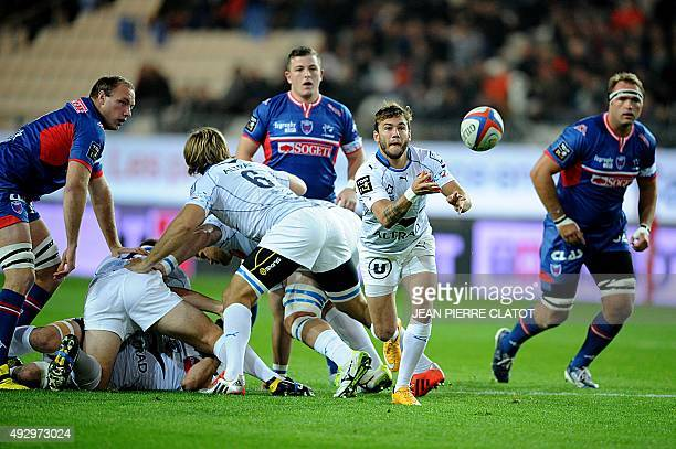 Montpellier's French winger Marvin O'Connor clears the ball out of a scrum during the French Top 14 rugby union match Grenoble versus Montpellier on...