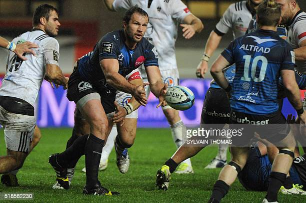 Montpellier's hooker Bismark Du Plessis passes the ball during the French Top 14 rugby Union match Montpellier vs Brive on April 01 at the Altrad...