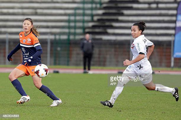 Montpellier's Japanese midfielder Rumi Utsugi fights for the ball with Juvisy's French midfielder Ines Jaurena during the French Women's Division 1...