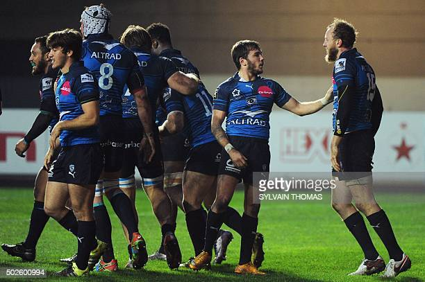 Montpellier's Jesse Mogg is congratulated by his teammates after scoring a try during the French Top 14 rugby Union match Montpellier vs Agen on...