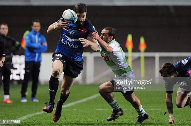 Montpellier's Julien Malzieu challenges Pau's Samuel Marques during the French Top 14 rugby union match between Montpellier and Pau at the Altrad...