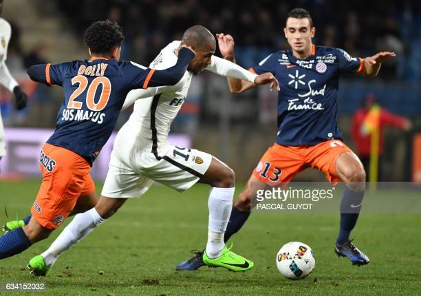 Montpellier's Keagan Dolly and Montpellier's French midfielder Ellyes Skhiri vies with Monaco's French defender Djibril Sidibe during the French L1...