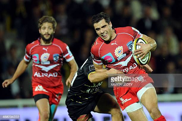 Montpellier's Lucas Dupont tries to avoid a tackle during the French Top 14 rugby union match between La Rochelle and Montpellier at the Marcel...