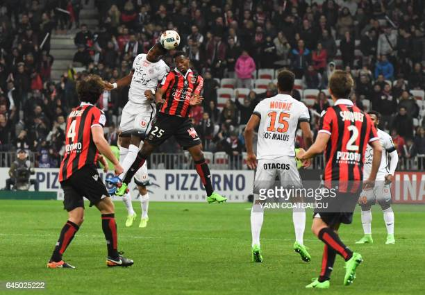 Montpellier's Malian midfielder Yacouba Sylla and Nices French midfielder Wylan Cyprien go for a header during the French L1 football match OGC Nice...