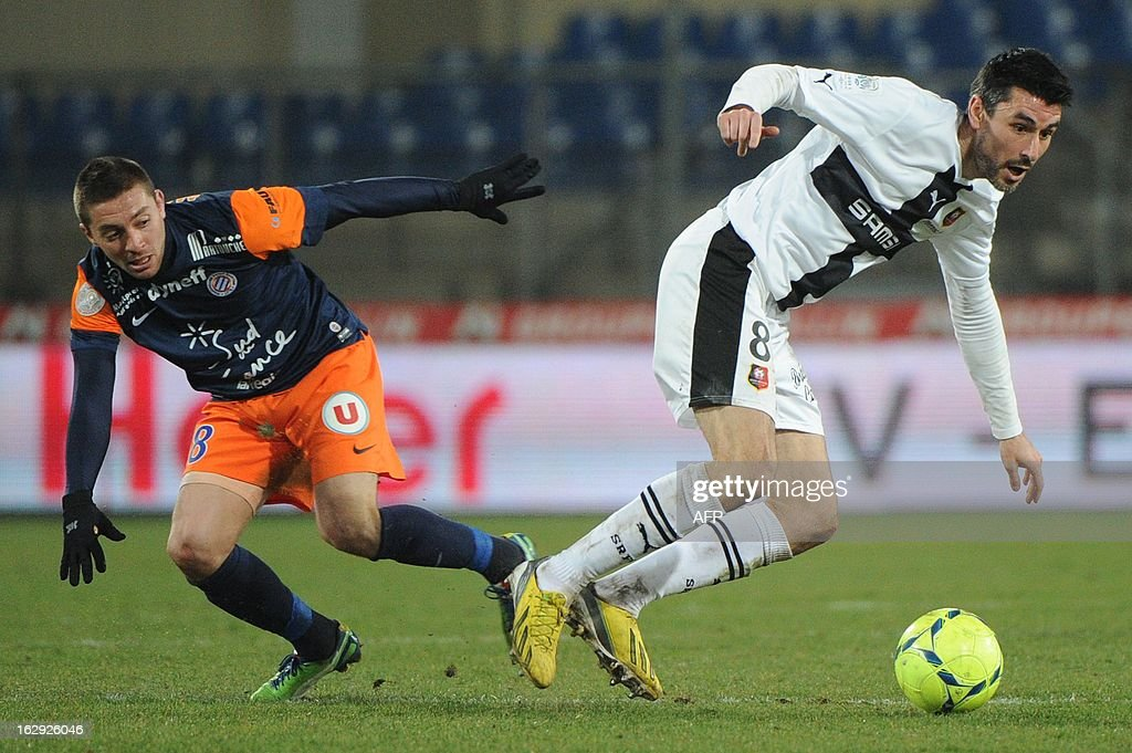 Montpellier's midfielder Anthony Mounier (L) vies with Rennes' midfielder Julien Feret (R) on March 1, 2013 during a French L1 football match at the Mosson stadium in the southern French city of Montpellier.