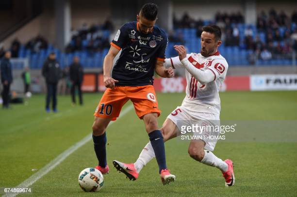 Montpellier's midfielder Ryad Boudebouz vies with Lille's French midfielder Julian Palmieri during the French L1 football match between Montpellier...