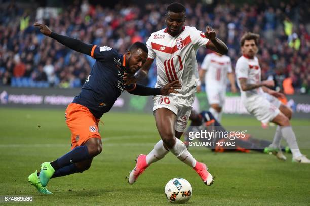 Montpellier's midfielder Stephane Sessegnon vies with Lille's defender Ibrahim Amadou during the French L1 football match between Montpellier and...