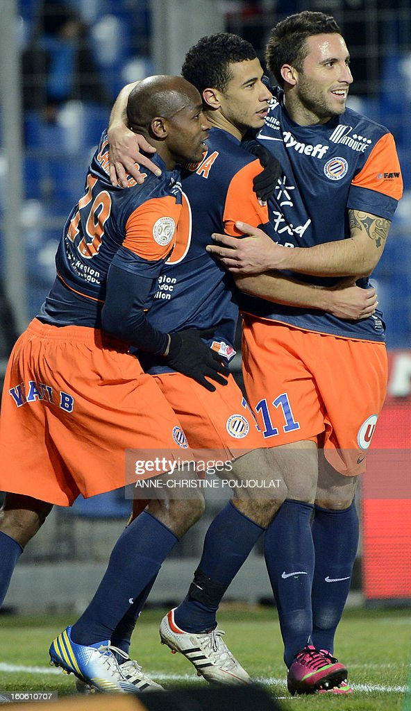 Montpellier's Moroccan midfielder Younes Belhanda (C) is congratulated by Senegalese forward Souleymane Camara (L) and Argentinian forward Emmanuel Herrera (R) after scoring a goal during a French L1 football match between Montpellier and Reims on February 3, 2013 at the Mosson stadium in Montpellier, southern France. AFP PHOTO / ANNE-CHRISTINE POUJOULAT