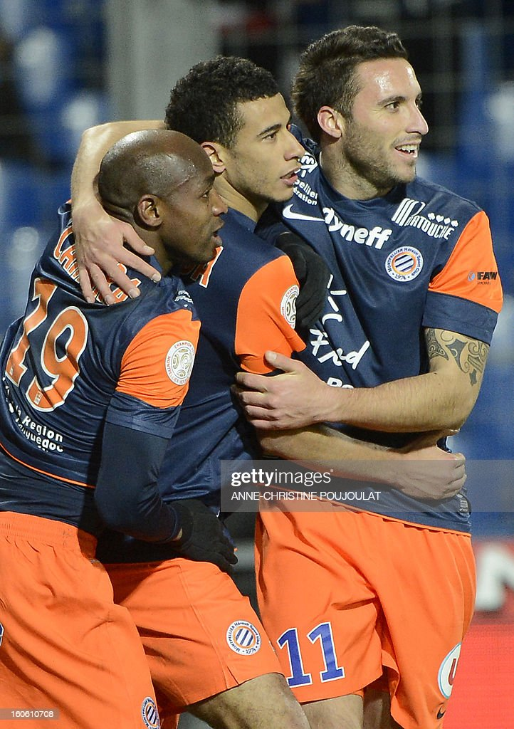 Montpellier's Moroccan midfielder Younes Belhanda (C) is congratulated by Senegalese forward Souleymane Camara (L) and Argentinian forward Emmanuel Herrera (R) after scoring a goal during a French L1 football match between Montpellier and Reims on February 3, 2013 at the Mosson stadium in Montpellier, southern France.