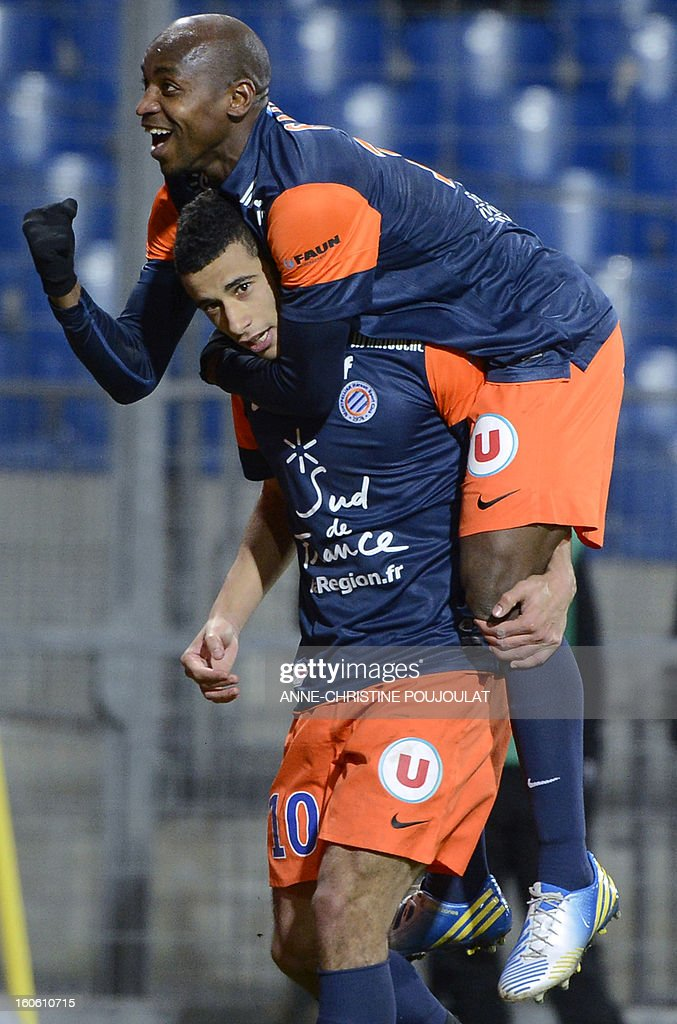Montpellier's Moroccan midfielder Younes Belhanda (bottom) is congratulated by Senegalese forward Souleymane Camara after scoring a goal during a French L1 football match between Montpellier and Reims on February 3, 2013 at the Mosson stadium in Montpellier, southern France.