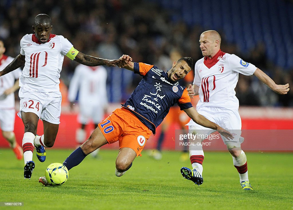 Montpellier's Moroccan midfielder Younes Belhanda (C) vies for the ball with Lille's French midfielder Rio Mavuba (L) and Lille's French midfielder Florent Balmont (R) during the French L1 football match Montpellier vs Lille on May 18, 2013 at the Mosson stadium in Montpellier, southern France.