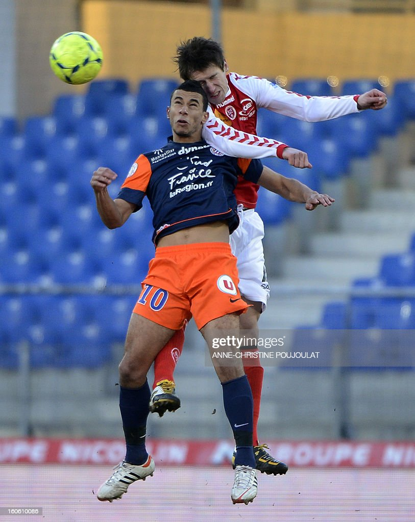 Montpellier's Moroccan midfielder Younes Belhanda (L) vies with Reims' Polish midfielder Grzegorz Krychowiak (R) during the French L1 championships football match Montpellier vs Reims on February 3, 2013 at the Mosson stadium in Montpellier.