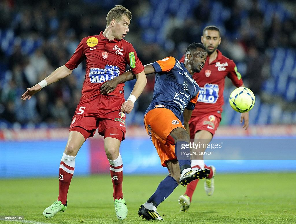 Montpellier's Nigerian forward John Utaka (R) vies for the ball with Brest's French defender Florian Lejeune (L) during the French L1 football match Montpellier vs Brest on May 4, 2013 at the Mosson stadium in Montpellier, southern France. AFP PHOTO / PASCAL GUYOT