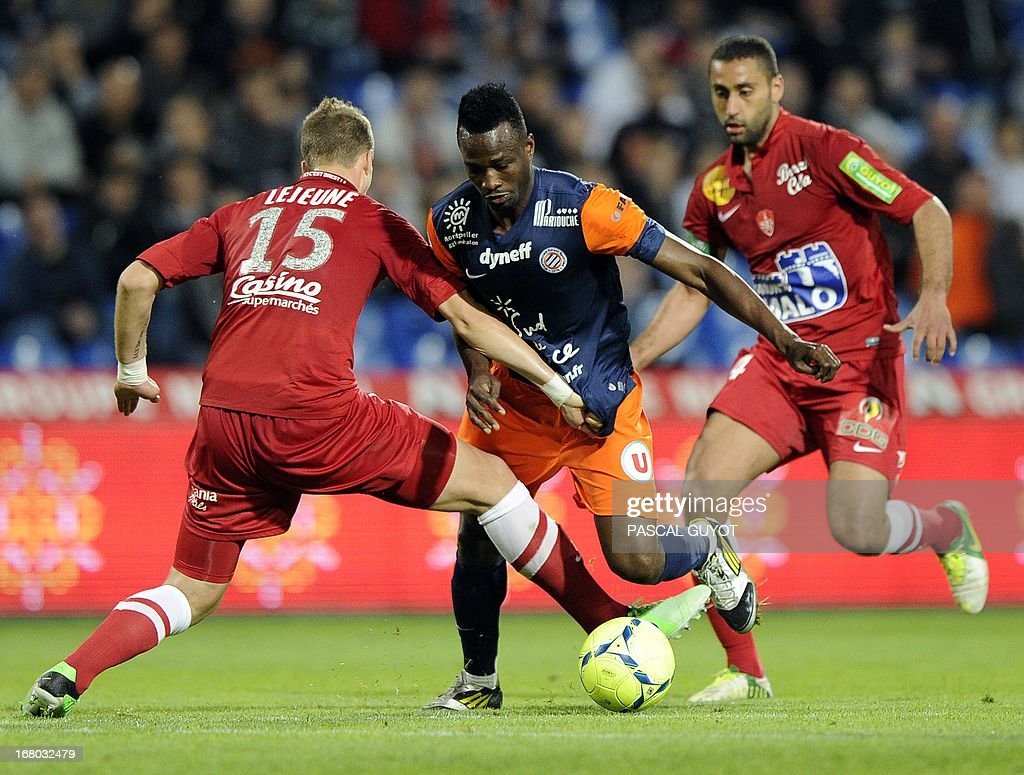 Montpellier's Nigerian forward John Utaka (C) vies with Brest's French defender Florian Lejeune (L) and Brest's French defender Ahmed Kantari (R) during the French L1 football match Montpellier vs Brest on May 4, 2013 at the Mosson stadium in Montpellier, southern France.