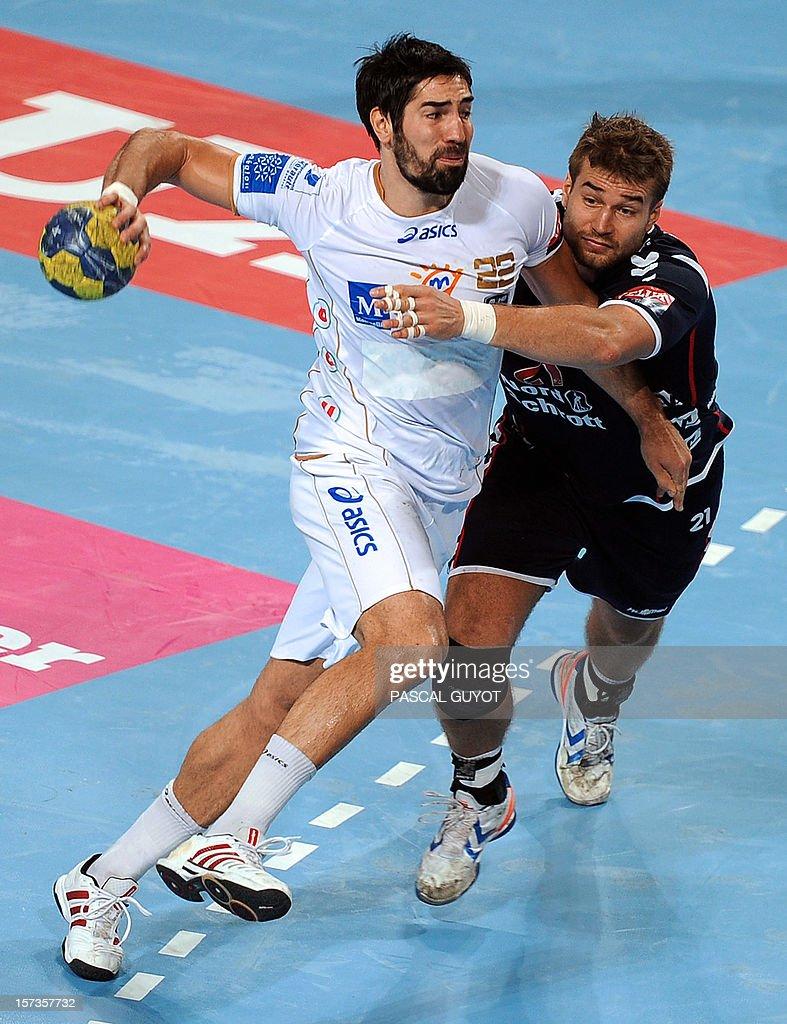Montpellier's Nikola Karabatic (L) vies with Flensburg's Jacob Heinl (R) during the Champions League handball match Montpellier AHB vs SG Flensburg-Handewitt, on December 2, 2012 at the Arena hall in Montpellier, southern France. Flensburg won 27-25.
