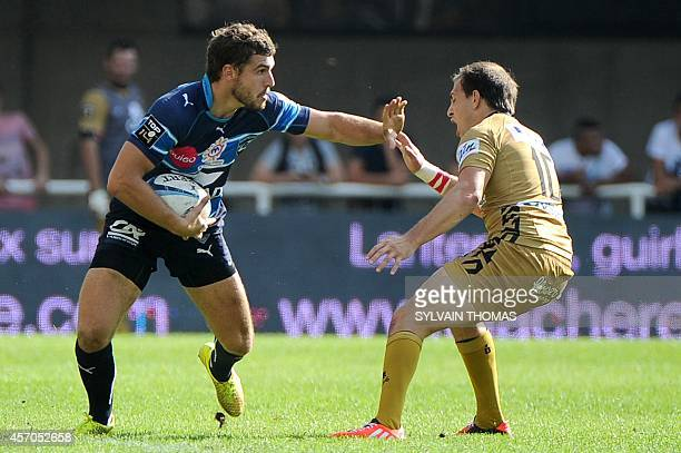 Montpellier's Pierre Berard vies with Oyonnax's Benjamin Urdapilleta during the French Top 14 rugby Union match Montpellier vs Oyonnax on October 11...