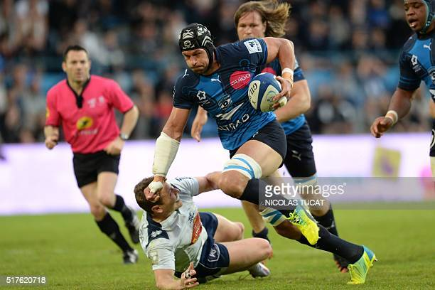 Montpellier's Pierre Johan Spies runs to score a try during the French Top 14 rugby union match between Agen and Montpellier on March 26 2016 at the...
