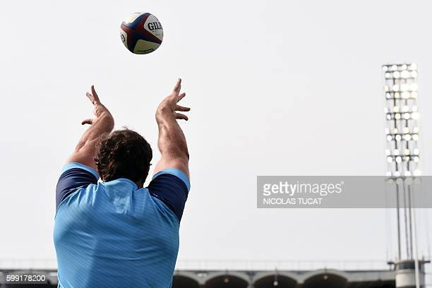 Montpellier's player throws the ball during a warm up prior to the French Top 14 rugby union match between BordeauxBegles and Montpellier on...