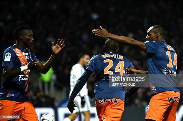 Montpellier's players celebrate after Lyon's French midfielder Maxime Gonalons scored an own goal during the French L1 football match between Lyon...