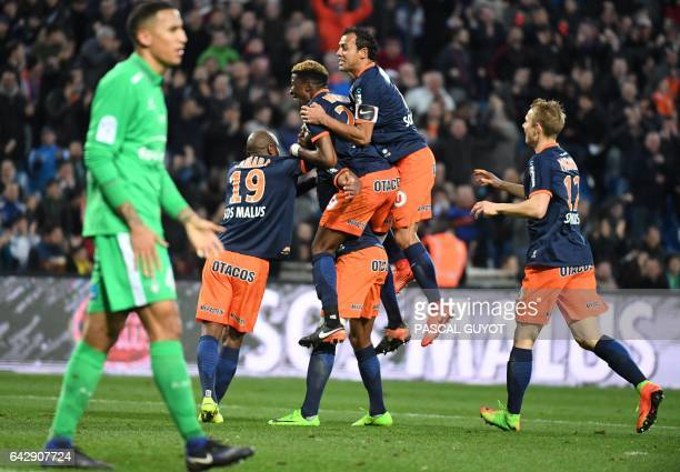 Montpellier's players celebrate after scoring a goal during the French L1 football match between MHSC Montpellier and AS Saint Etienne on February 19...