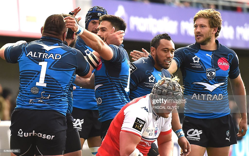Montpellier's players (back) celebrate after scoring a try during the French Top 14 rugby union match between Montpellier and Grenoble on April 30, 2016 at the Altrad stadium in Montpellier, southern France.