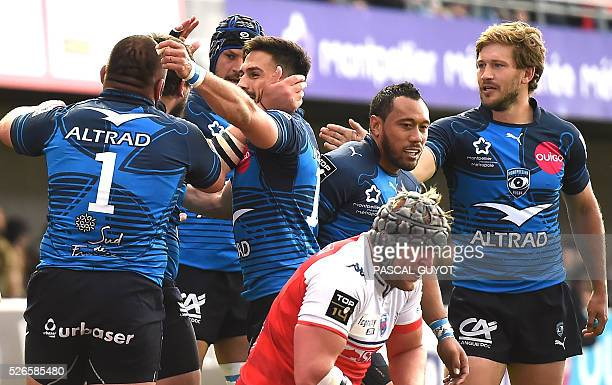 Montpellier's players celebrate after scoring a try during the French Top 14 rugby union match between Montpellier and Grenoble on April 30 2016 at...