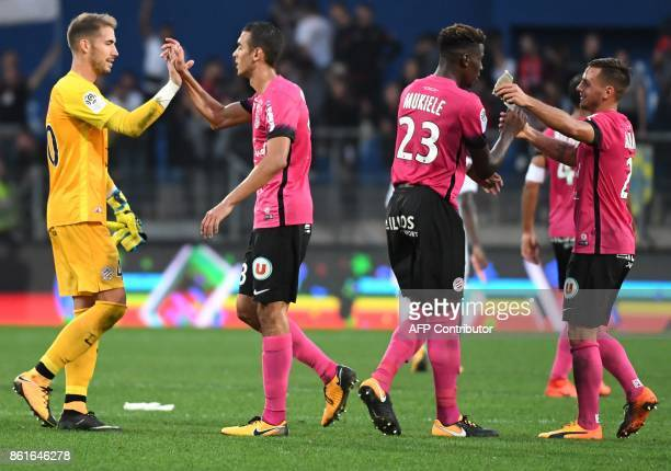 Montpellier's players react after winning against OGC Nice during the French Ligue 1 football match between MHSC Montpellier and Nice on October 15...