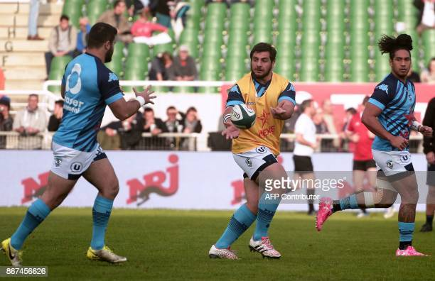 Montpellier's players warm up before the French Top 14 rugby union match between Pau and Montpellier at the Hameau Stadium in Pau southwestern France...