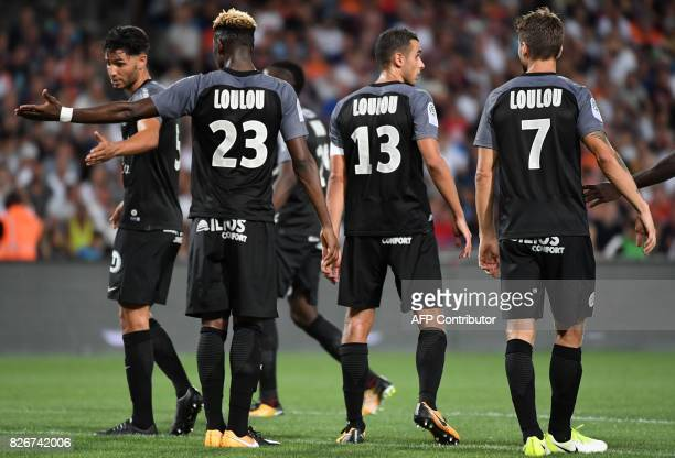 Montpellier's players with jerseys where is written 'Loulou' the nickname of the late president of the club of Montpellier Louis Nicollin react...