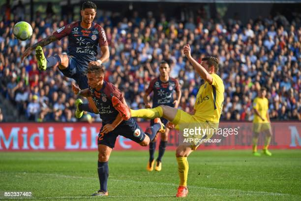 Montpellier's Portuguese defender Pedro Mendes and Montpellier's French defender Ruben Aguilar defend under pressure from Paris SaintGermain's German...