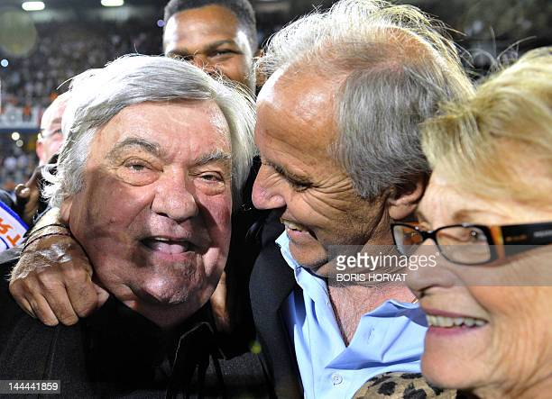 Montpellier's president Louis Nicollin celebrates with Montpellier's coach Rene Girard at the end of the French L1 football match Montpellier vs...