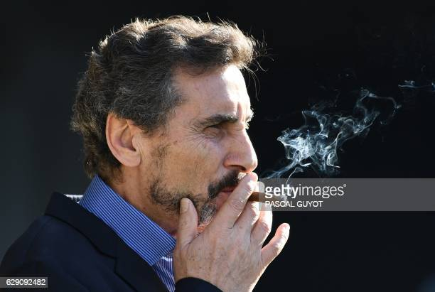 Montpellier's president Mohed Altrad smokes before the European Champions Cup rugby union match between Montpellier and Castres at the Altrad stadium...