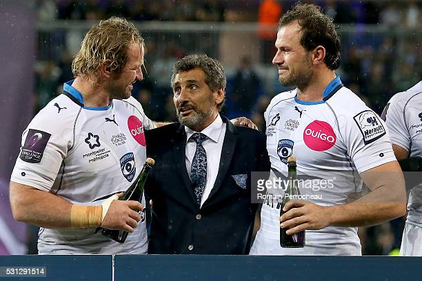 Montpellier's president Mohed Altrad talks with Jannie Du Plessis and Pierre Spies after the European Rugby Challenge Cup Final match between...