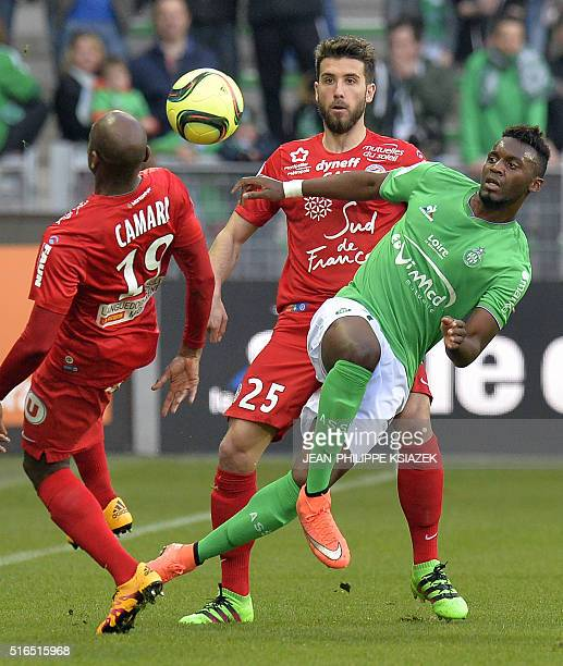 Montpellier's Senegalese forward Souleymane Camara and Montpellier's French defender Mathieu Deplagne vies with SaintEtienne's French forward...