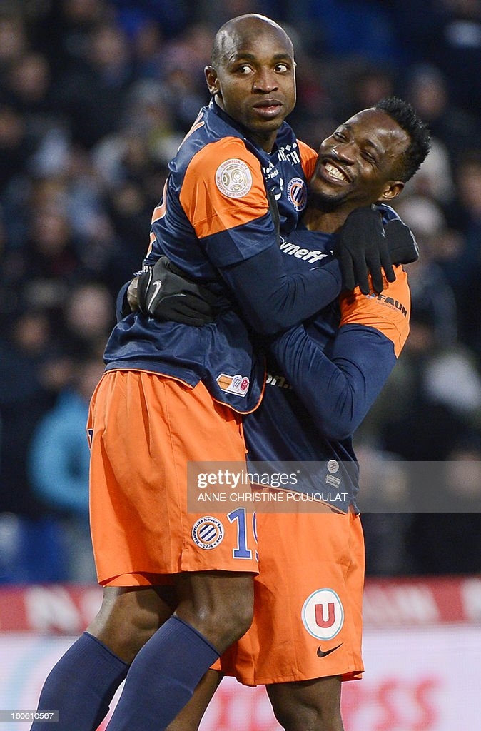 Montpellier's Senegalese forward Souleymane Camara (L) is congratulated by Nigerian forward John Utaka after scoring a goal during a French L1 football match between Montpellier and Reims on February 3, 2013 at the Mosson stadium in Montpellier, southern France.