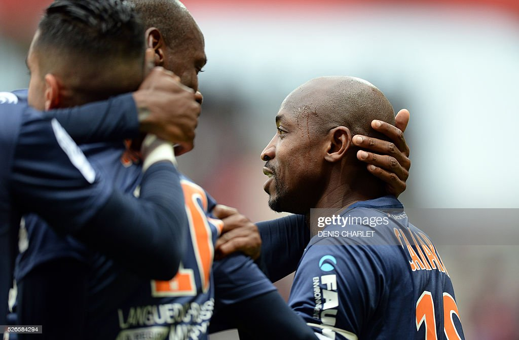 Montpellier's Senegalese forward Souleymane Camara (R) is congratulated by teammates after scoring a goal during the French L1 football match between Reims (SDR) and Montpellier (MHSC) on April 30 2016, at the Auguste Delaune Stadium in Reims, eastern France.