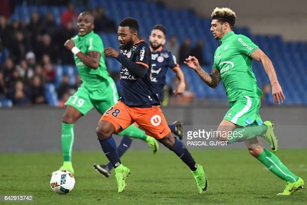 Montpellier's Senegalese forward Souleymane Camara outruns SaintEtienne's Guinean defender Florentin Pogba and SaintEtienne's French defender Kevin...