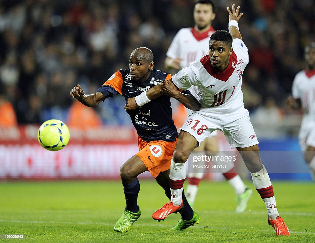 Montpellier's Senegalese forward Souleymane Camara (L) vies for the ball with Lille's French defender Franck Beria (L) during the French L1 football match Montpellier vs Lille on May 18, 2013 at the Mosson stadium in Montpellier, southern France.