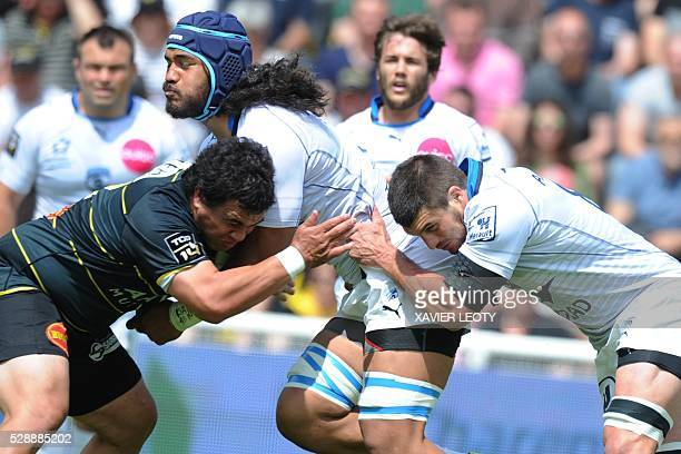 Montpellier's Sitaleki Timani runs with the ball during the French Top 14 rugby union match La Rochelle vs Montpellier on May 7 2016 at the Marcel...