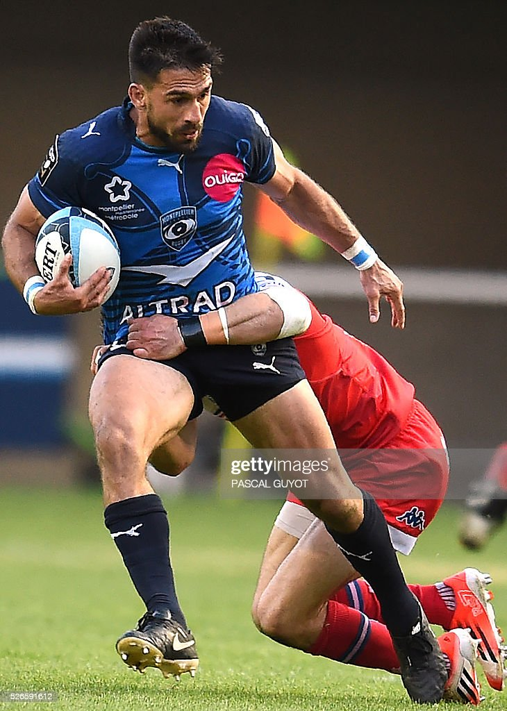Montpellier's South African centre Robert Ebersohn (L) vies with Grenoble's French flyhalf Gilles Bosch (R) during the French Top 14 rugby union match between Montpellier and Grenoble on April 30, 2016 at the Altrad stadium in Montpellier, southern France.