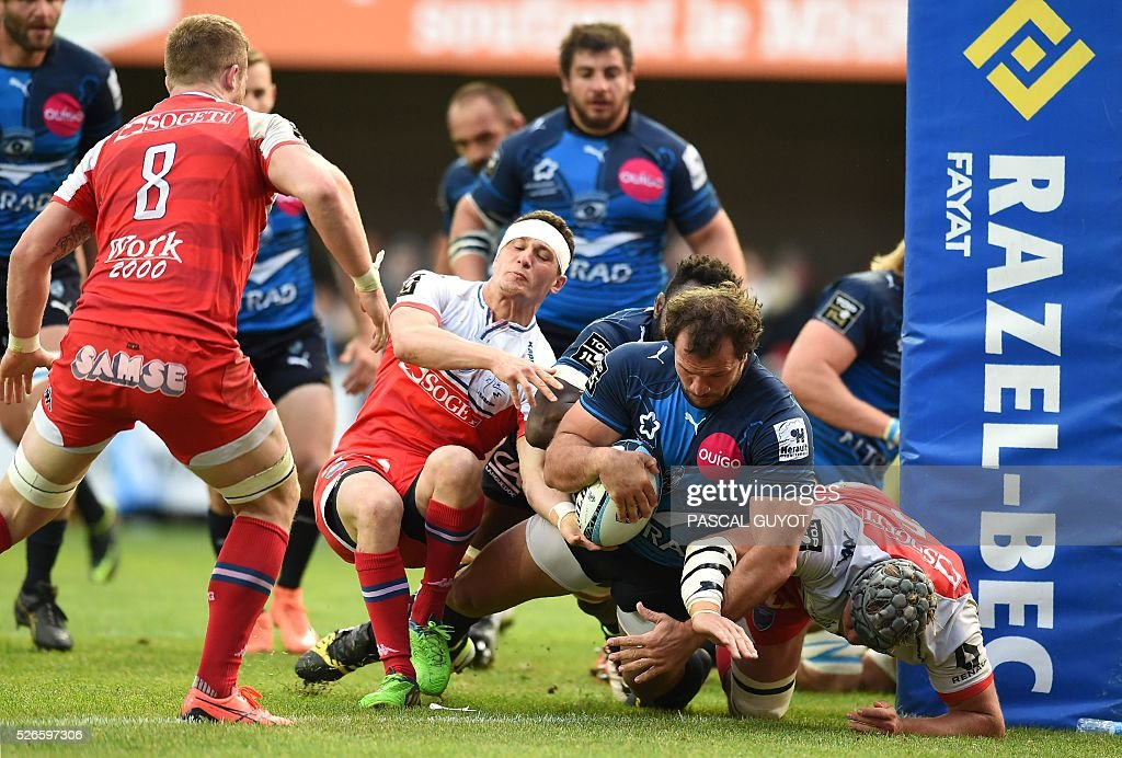 Montpellier's South African hooker Bismarck Du Plessis (2ndR) scores a try during the French Top 14 rugby union match between Montpellier and Grenoble on April 30, 2016 at the Altrad stadium in Montpellier, southern France.