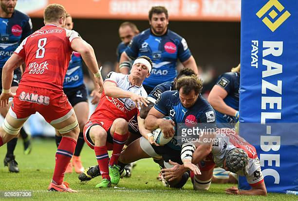 Montpellier's South African hooker Bismarck Du Plessis scores a try during the French Top 14 rugby union match between Montpellier and Grenoble on...