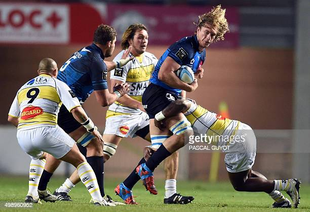 Montpellier's South African lock Jacques du Plessis is tackled during the French Top14 rugby union match between Montpellier and La Rochelle on...