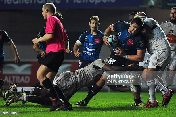 Montpellier's South African lock Paul Willemse vies with Agen's Fijian lock Apisalome Ratuniyarawa and Agen's Potuguese hooker Mike Tadjer during the...
