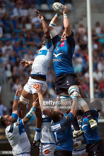 Montpellier's South African lock Paul Willemse vies with Castres French flanker Alexandre Bias as they try to grab a ball in a lineout during the...