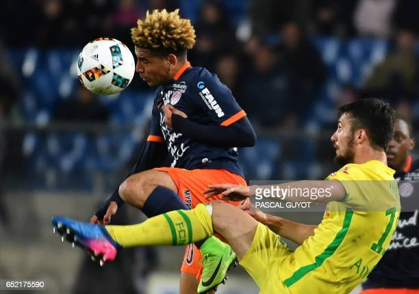 Montpellier's South African midfielder Keagan Dolly heads the ball as Nantes' French defender Leo Dubois looks on during the French L1 football match...