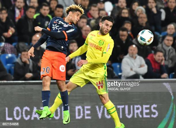 Montpellier's South African midfielder Keagan Dolly vies with Nantes' French midfielder Adrien Thomasson during the French L1 football match MHSC...