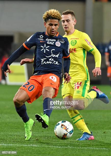 Montpellier's South African midfielder Keagan Dolly vies with Nantes' French midfielder Valentin Rongier during the French L1 football match between...